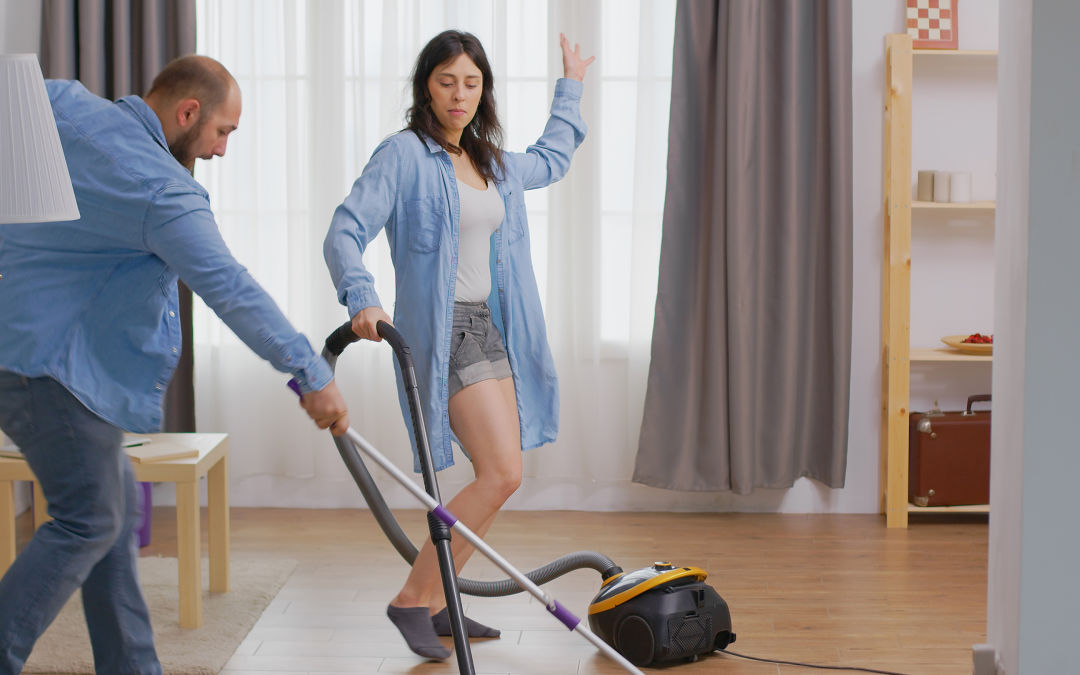 Image of family dancing while vacuuming.