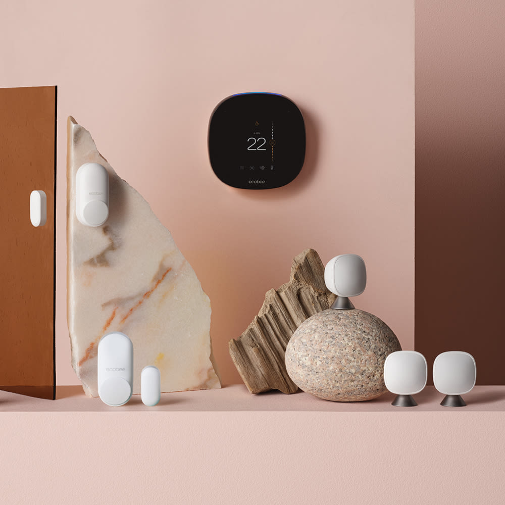 SmartThermostat with voice control, SmartCamera with voice control, 3 SmartSensors, and 2 SmartSensors for doors & windows floating on a blue background.