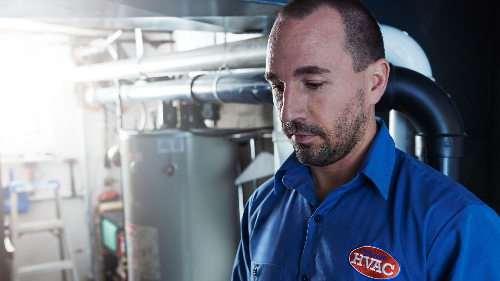 ecobee-trained technician Brandon Aldridge inspects customers HVAC system