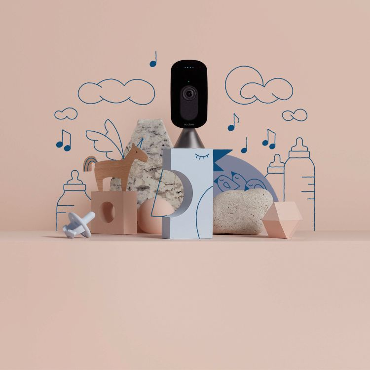 The ecobee SmartCamera on a pink background.