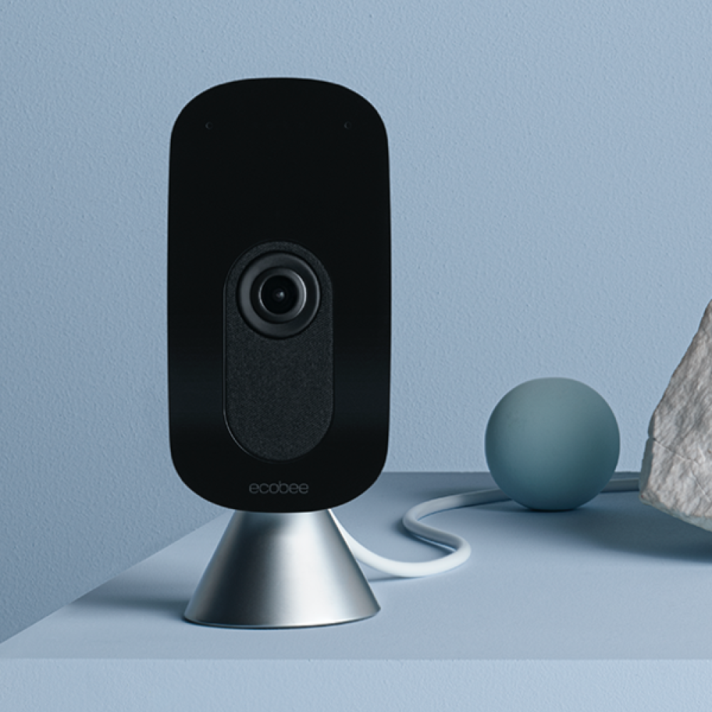 Smart Camera facing forward on powder blue background.