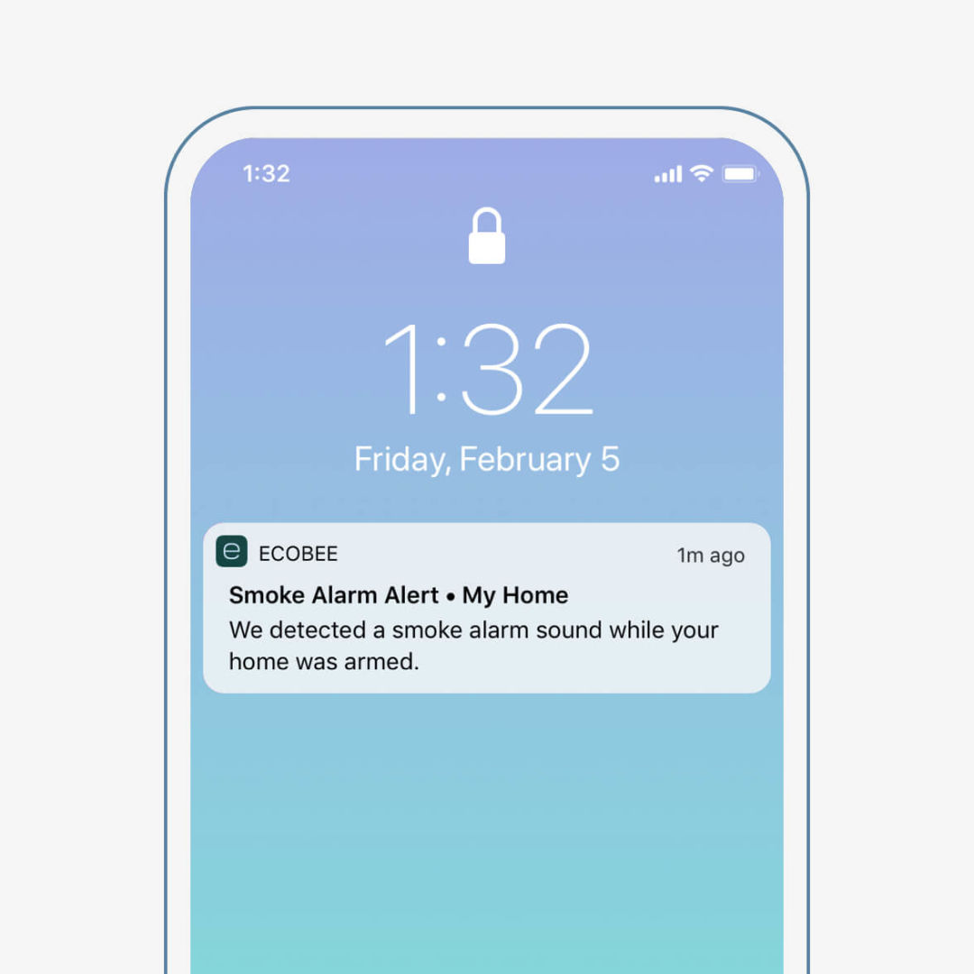 "A phone screen shows a notification from ecobee that says ""Smoke alarm alert - my home: We detected a smoke alarm sound while your home was armed."""