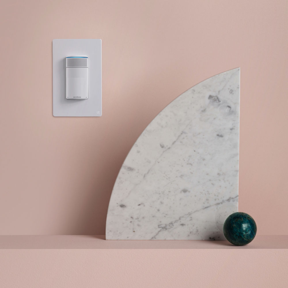 Light switch on pink wall