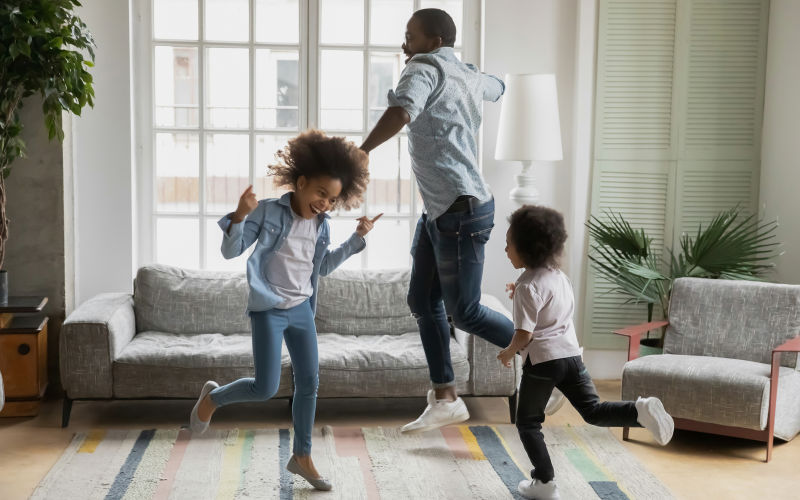 A family dance around a living room.