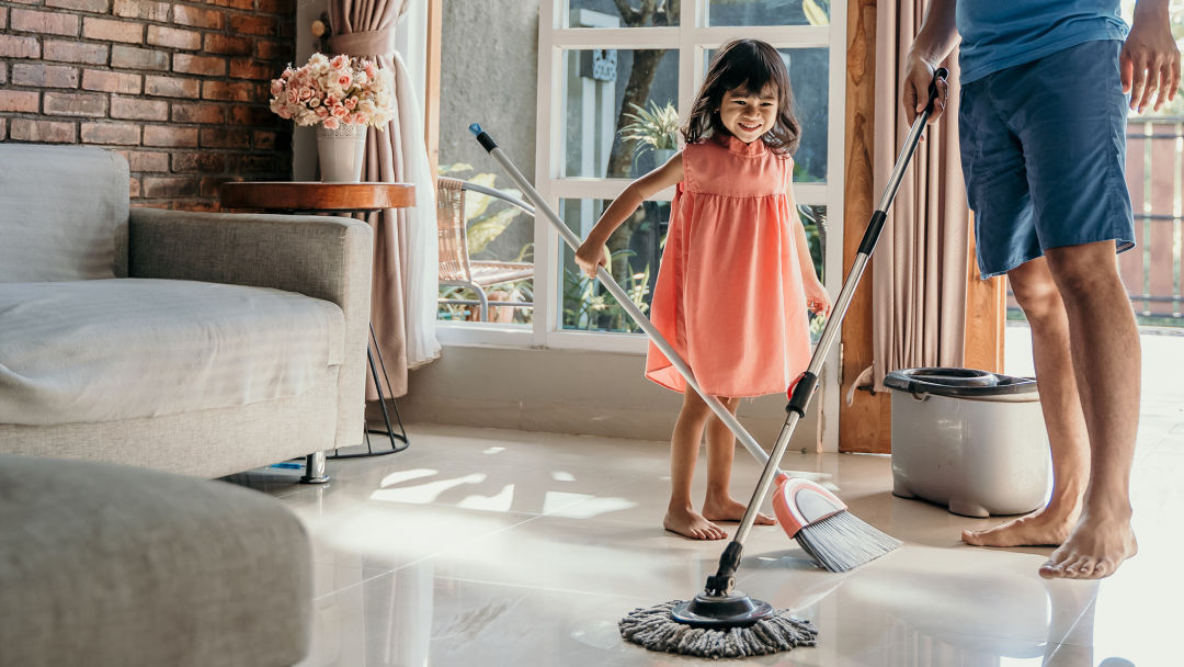 Image of family mopping and sweeping.