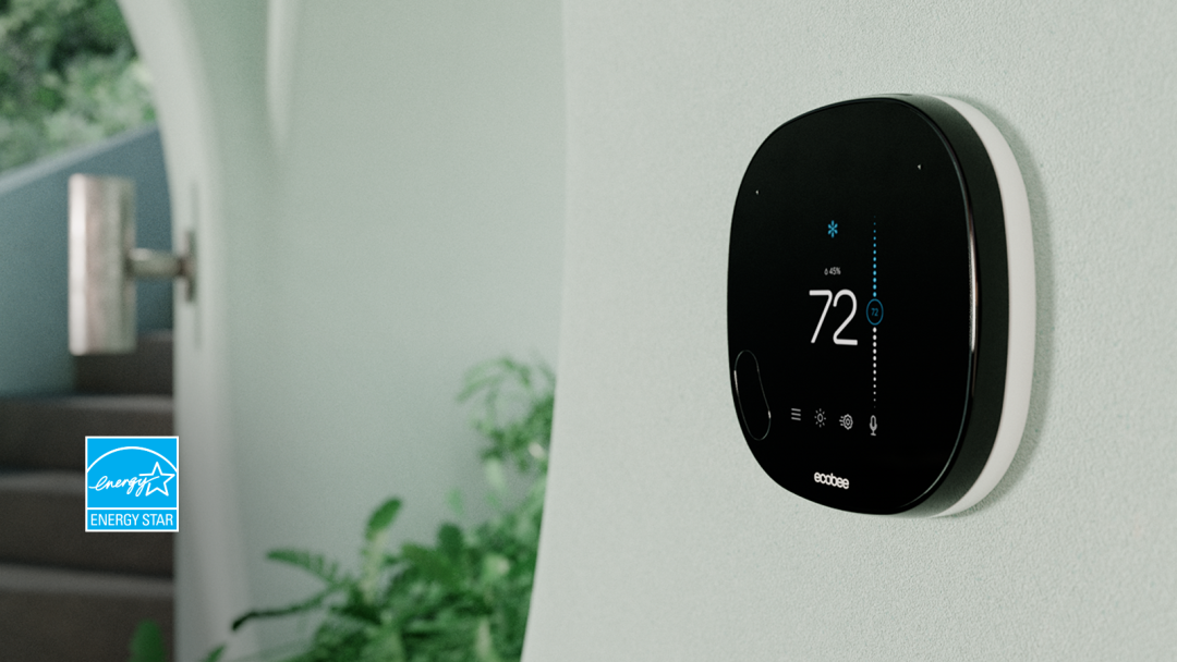ecobee SmartThermostat with voice control on white wall with ENERGY STAR logo.