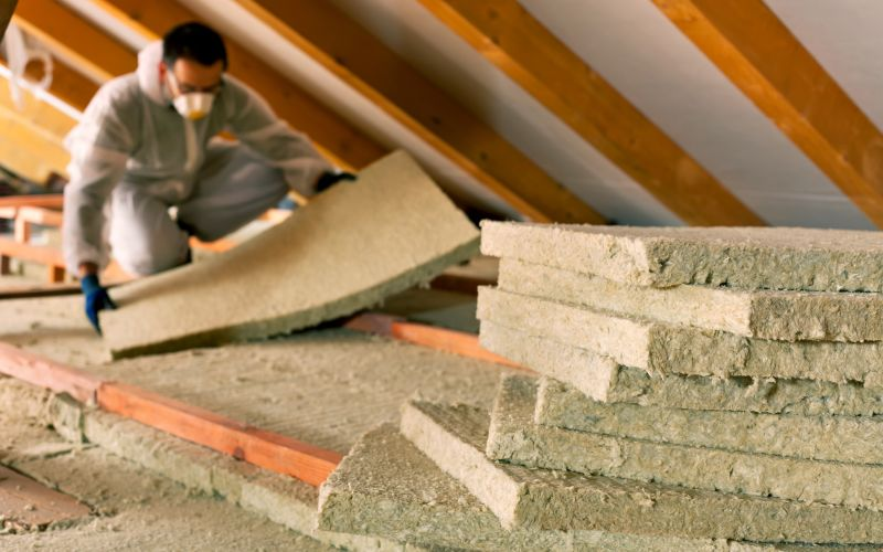 Professional contractor adding insulation to attic