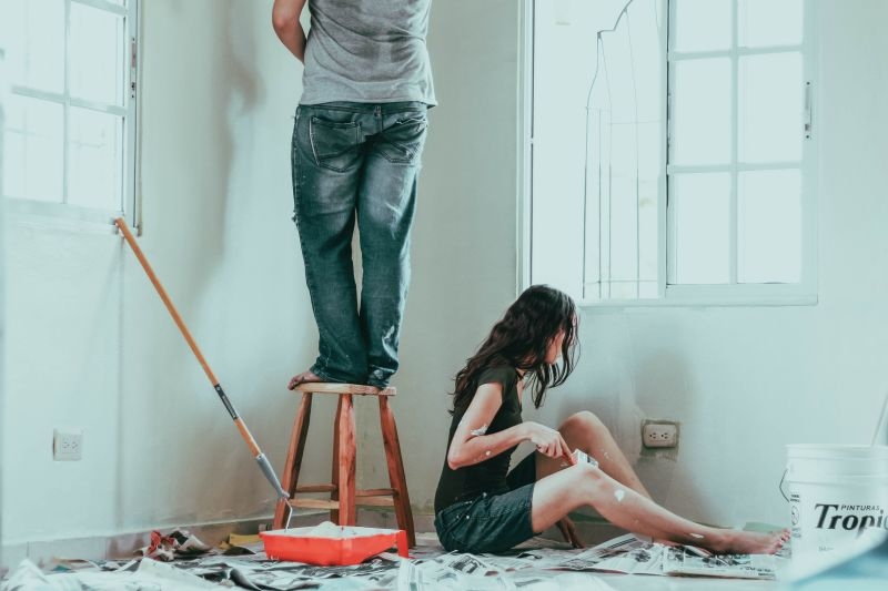 Man and women paint the nursery.