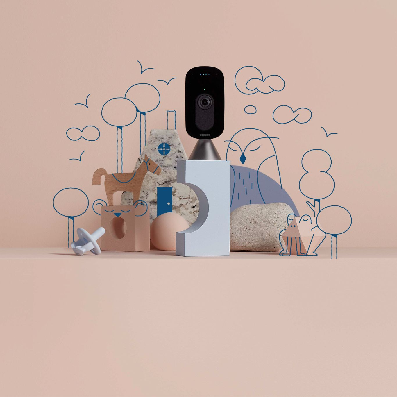 The ecobee SmartCamera sits amongst blue and pink blocks and toys.