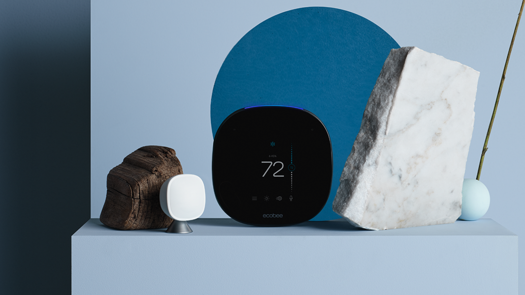 An ecobee thermostat and sensor on a blue background.
