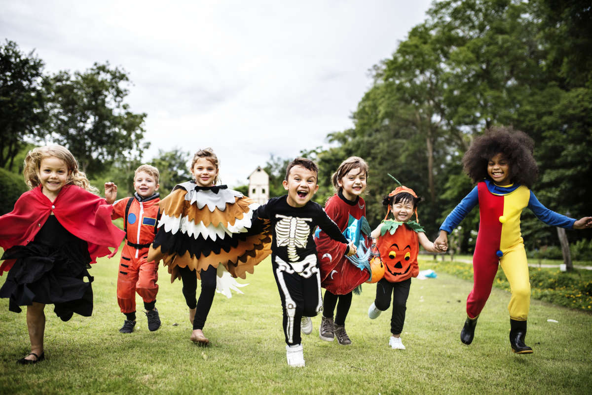 kids in costumes - iStock-1030383314