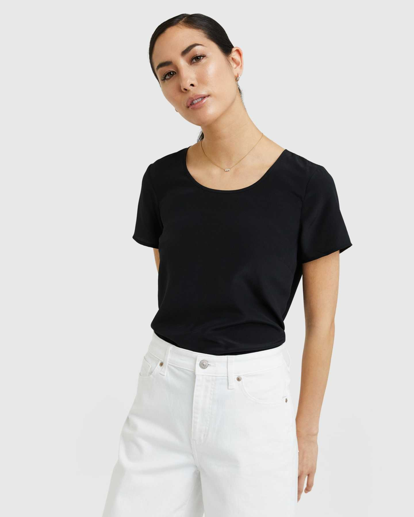 Woman wearing silk tee in black zoomed in