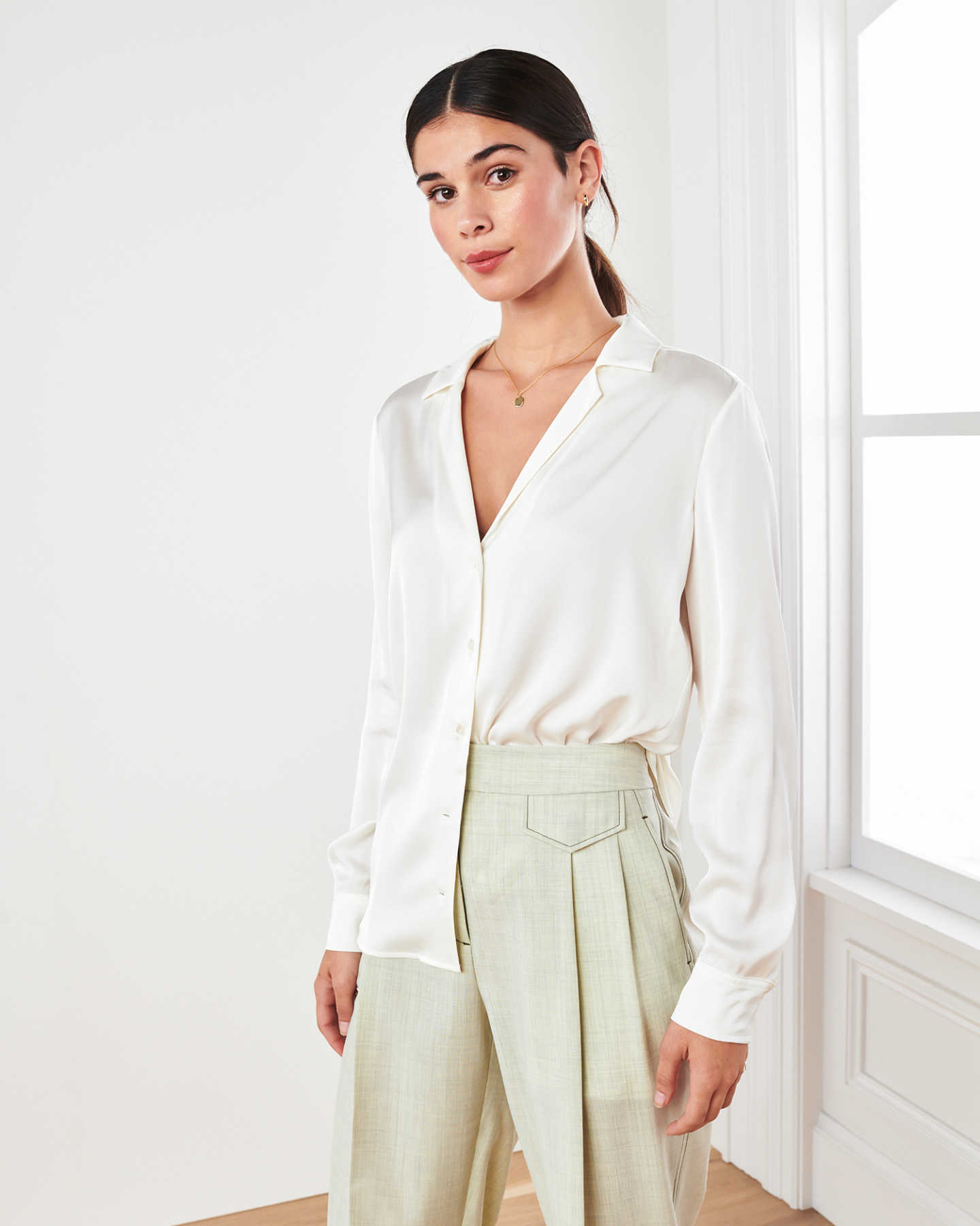 woman wearing silk notch collar blouse in ivory