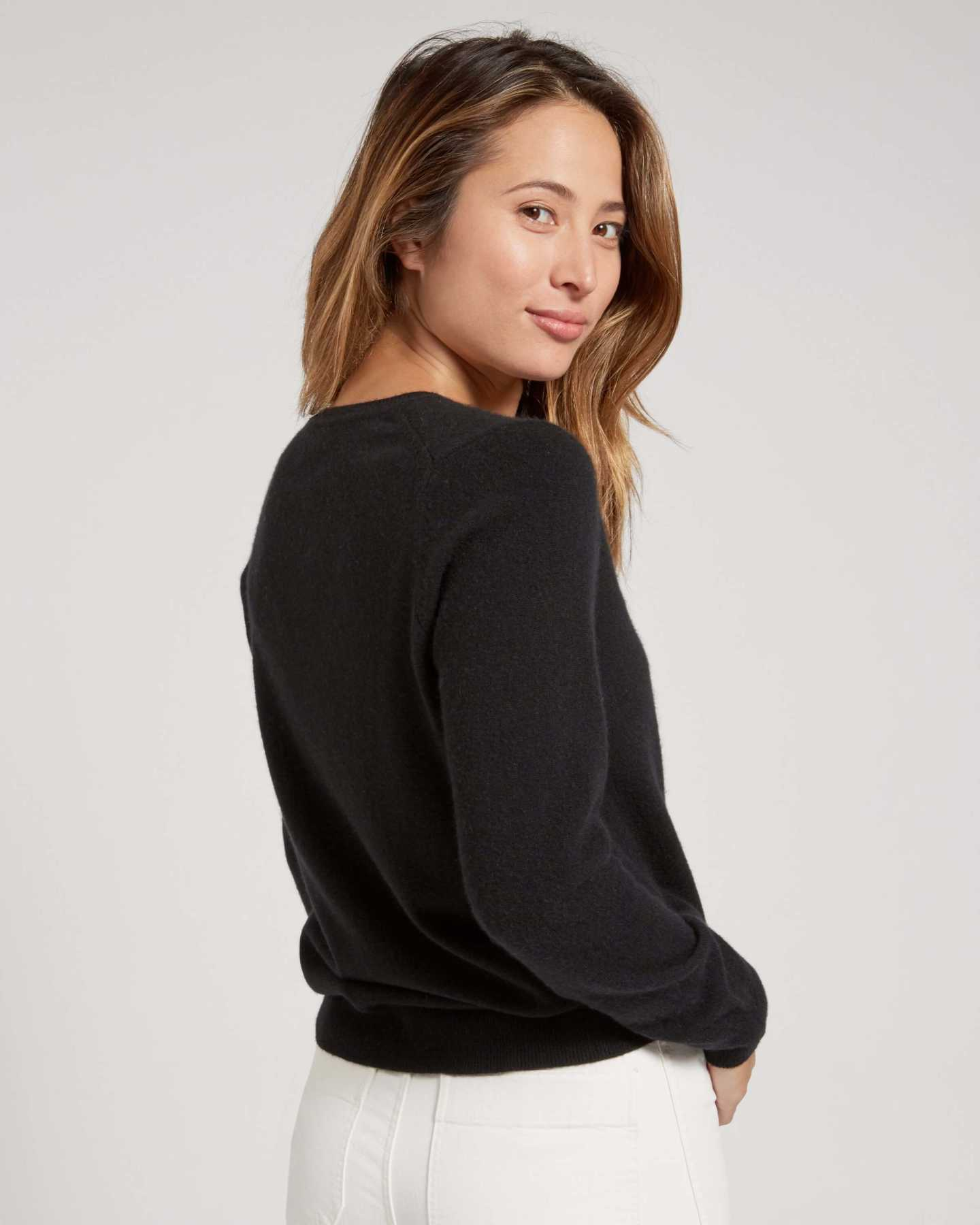 black cashmere v-neck sweater for women looking back