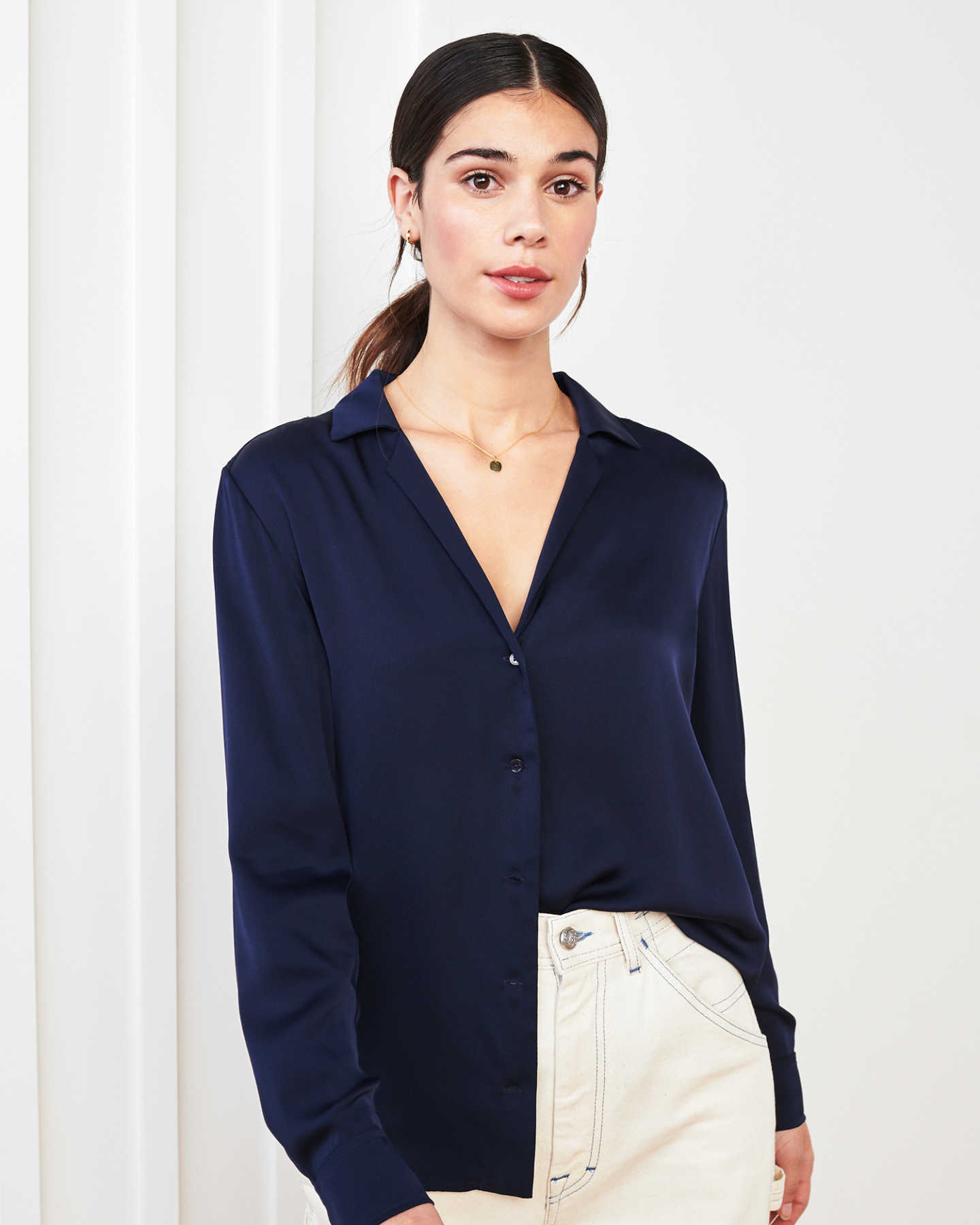 woman wearing silk notch collar blouse in navy