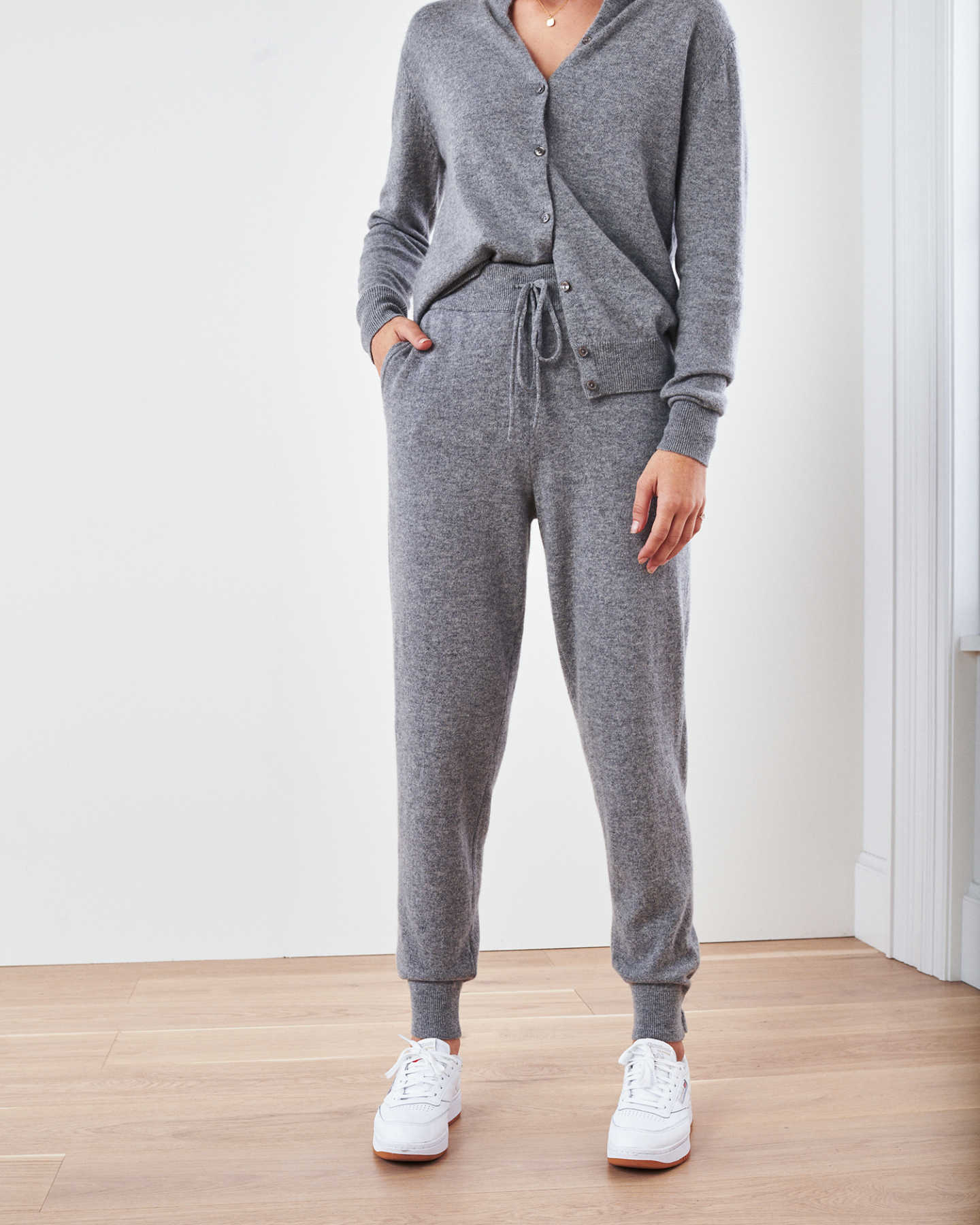 Woman wearing grey cashmere sweatpants & cashmere joggers with cardigan