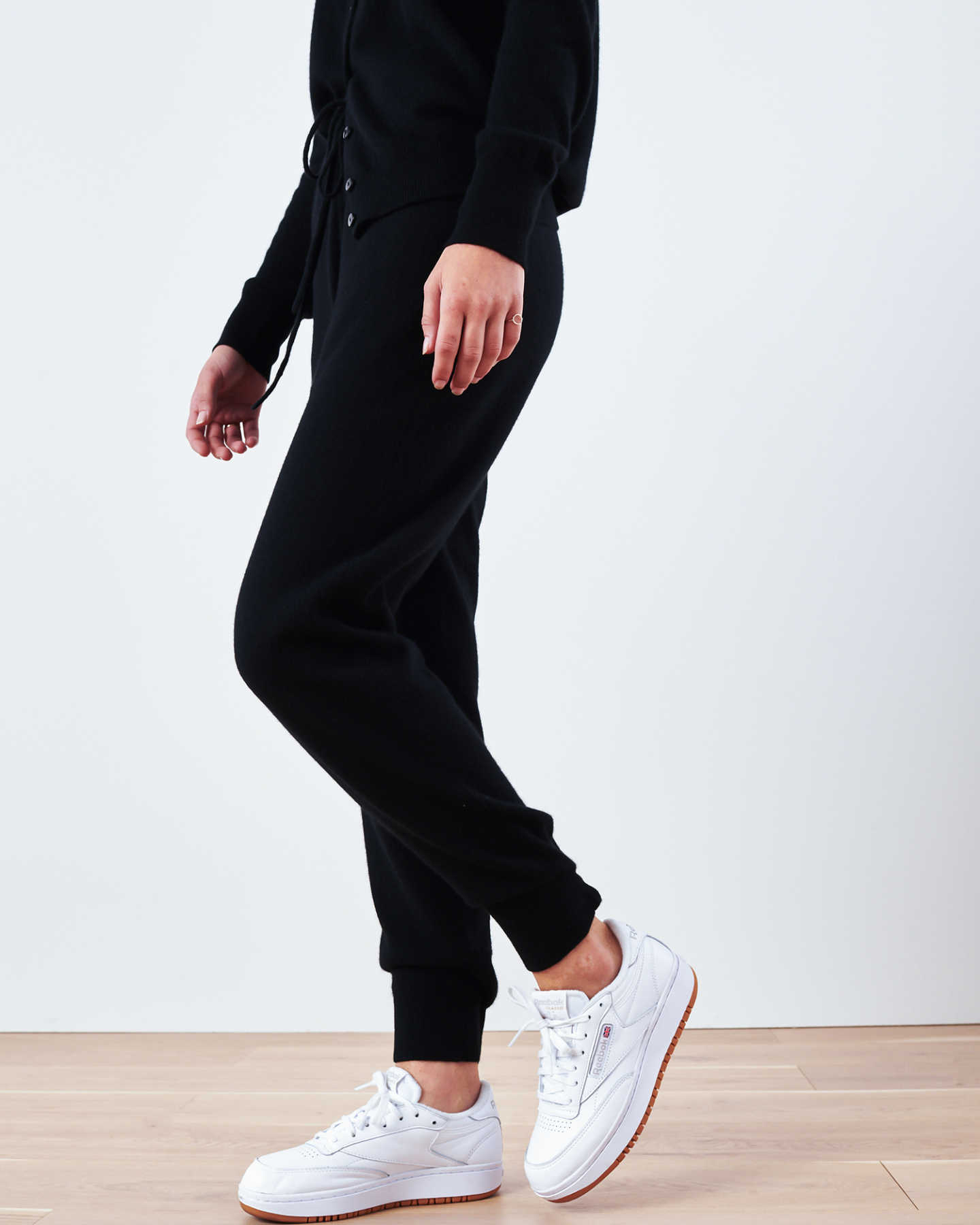 Woman wearing black cashmere sweatpants & cashmere joggers and cardigan