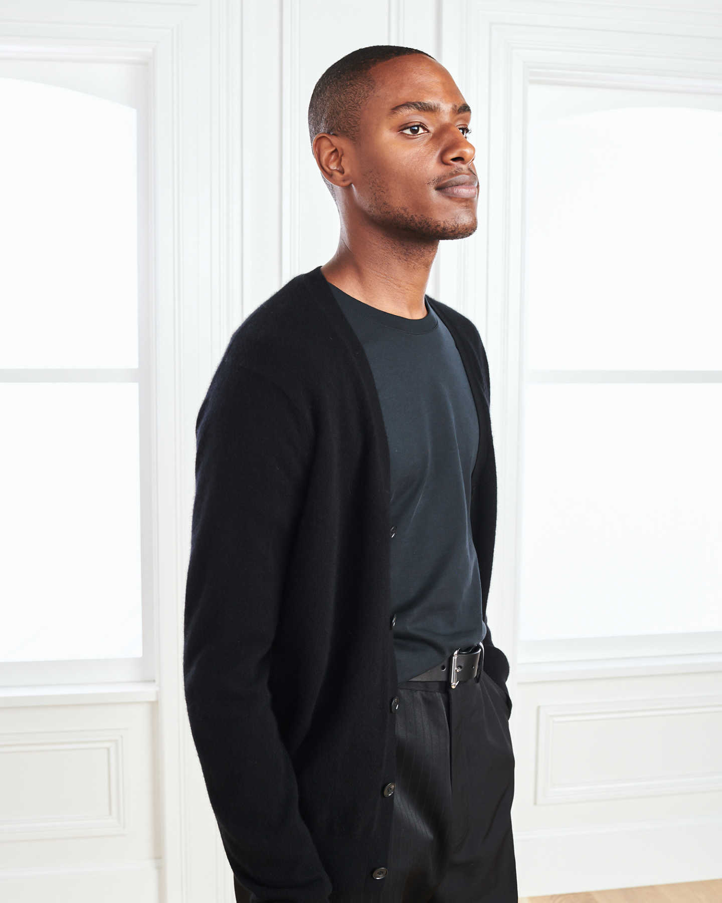 Men's cashmere cardigan sweater in black staring