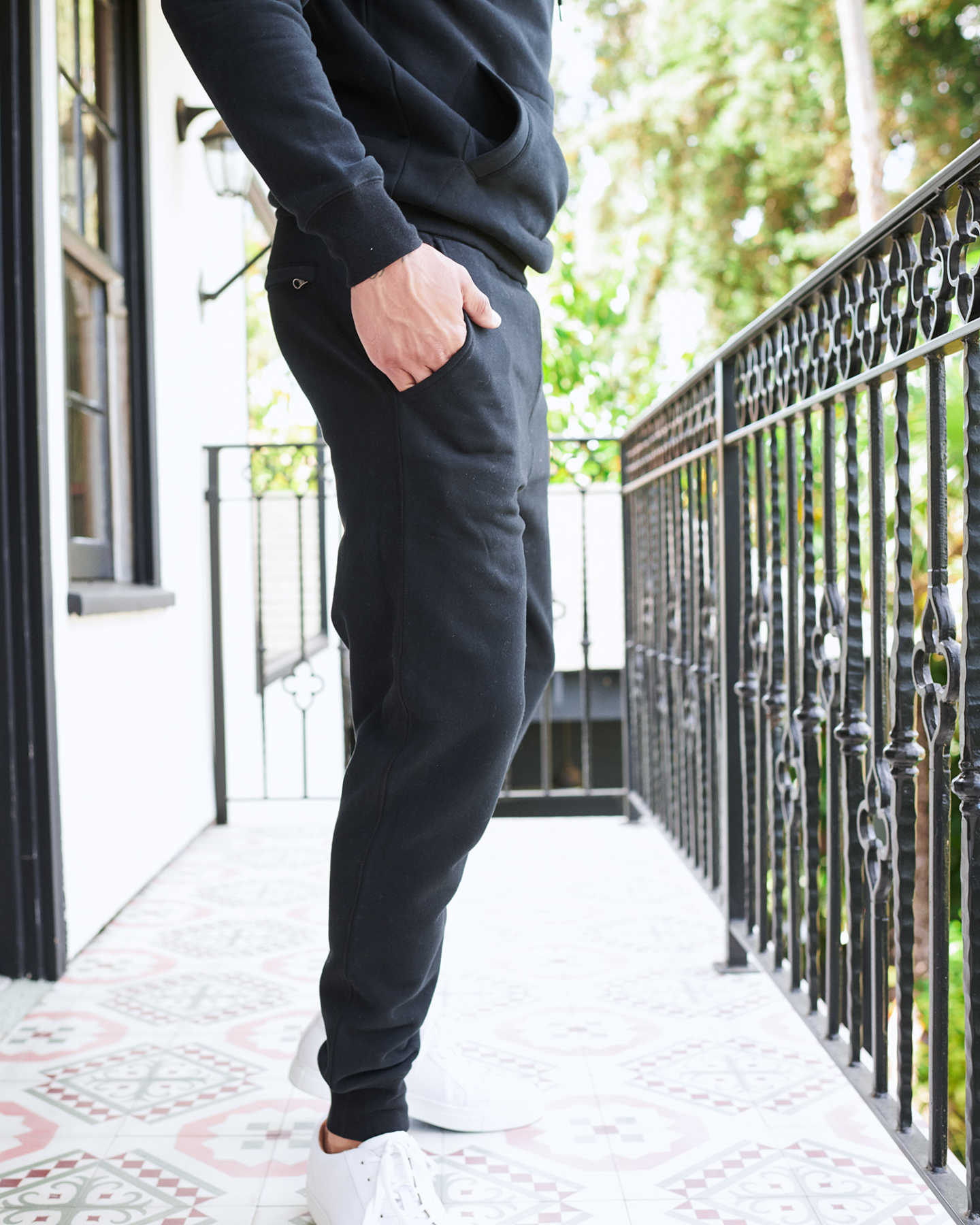 Man wearing 100% organic cotton heavyweight sweatpants in black from side