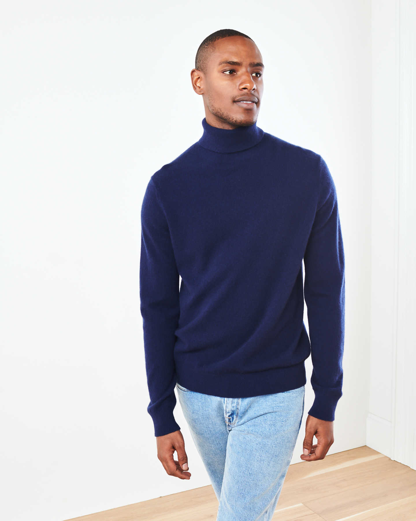 Man wearing navy men's cashmere turtleneck sweater