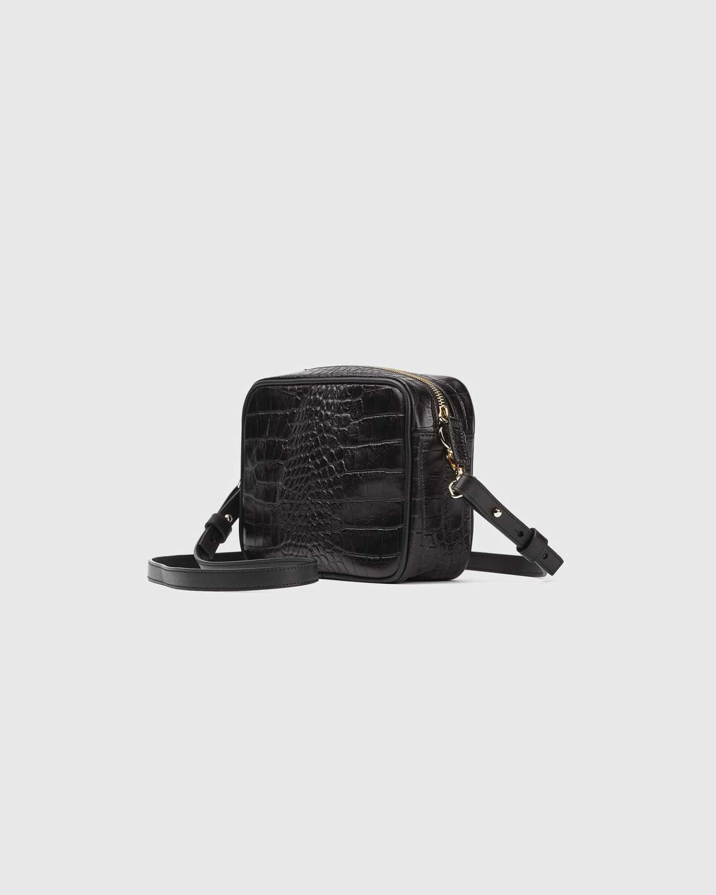 Leather crossbody bag with croco emboss design from angle