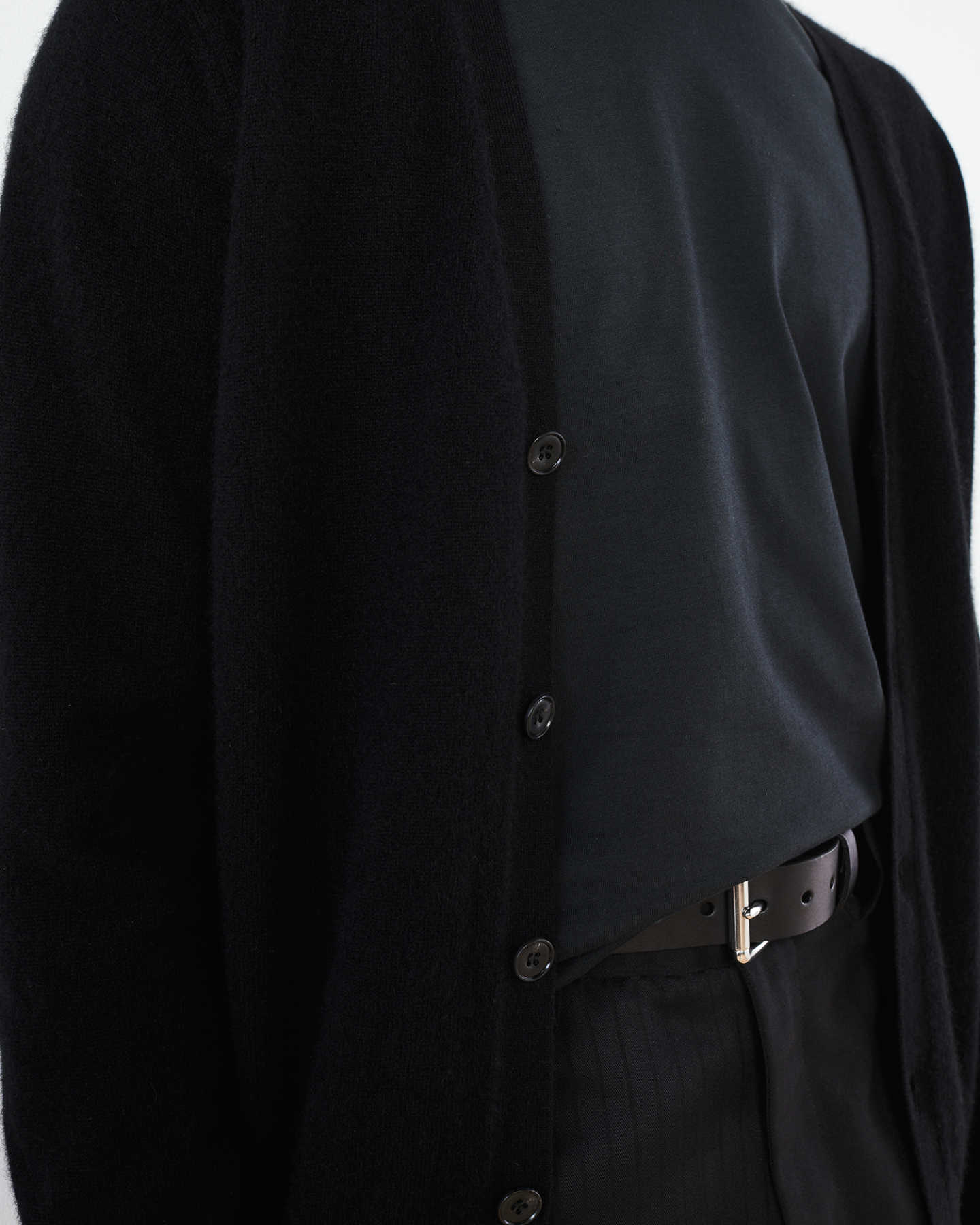 Men's cashmere cardigan sweater in black zoomed in