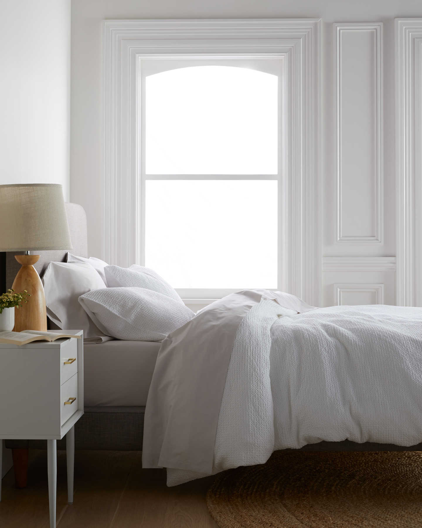 White waffle duvet cover set on bed from side