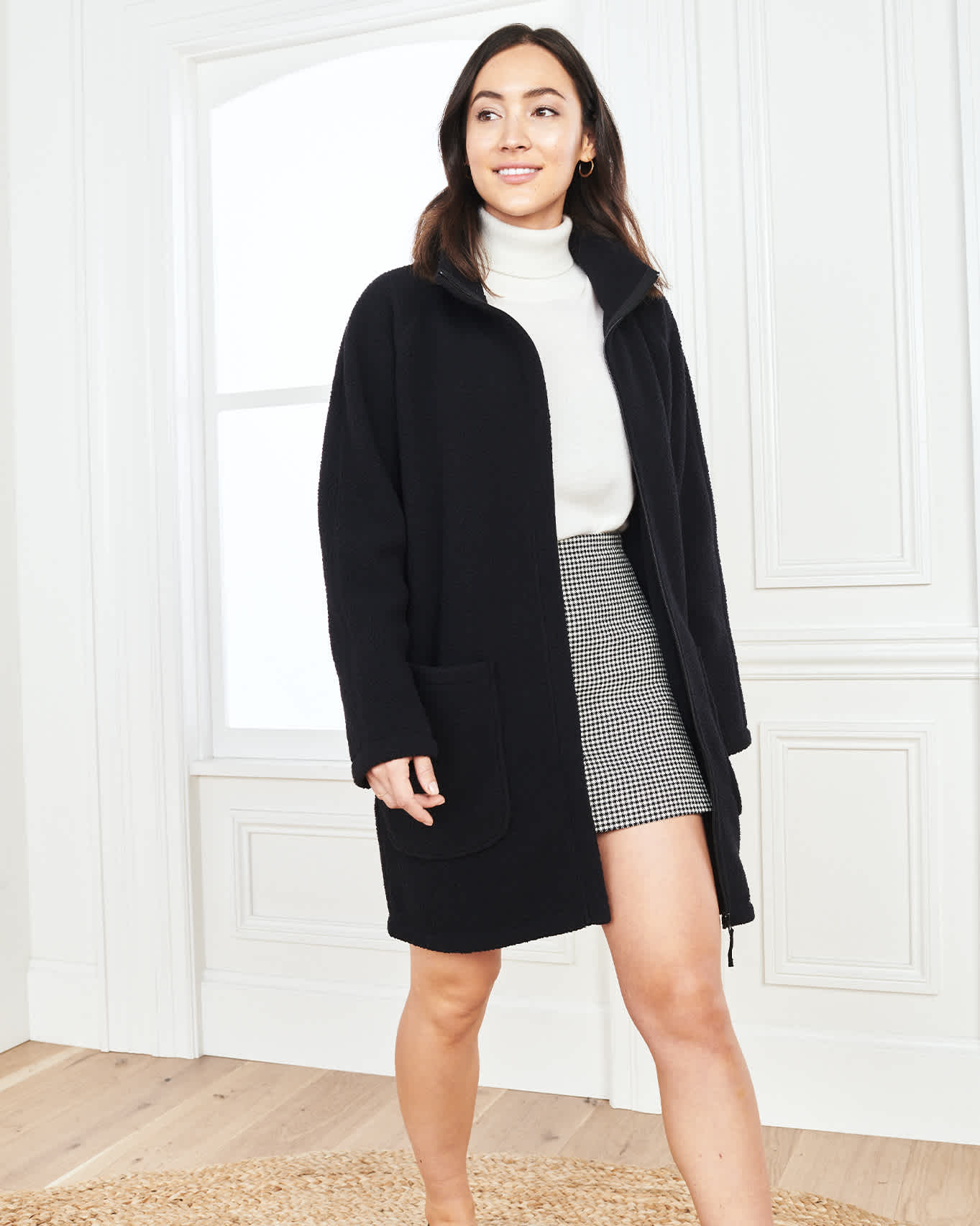 woman wearing long sherpa coat in black