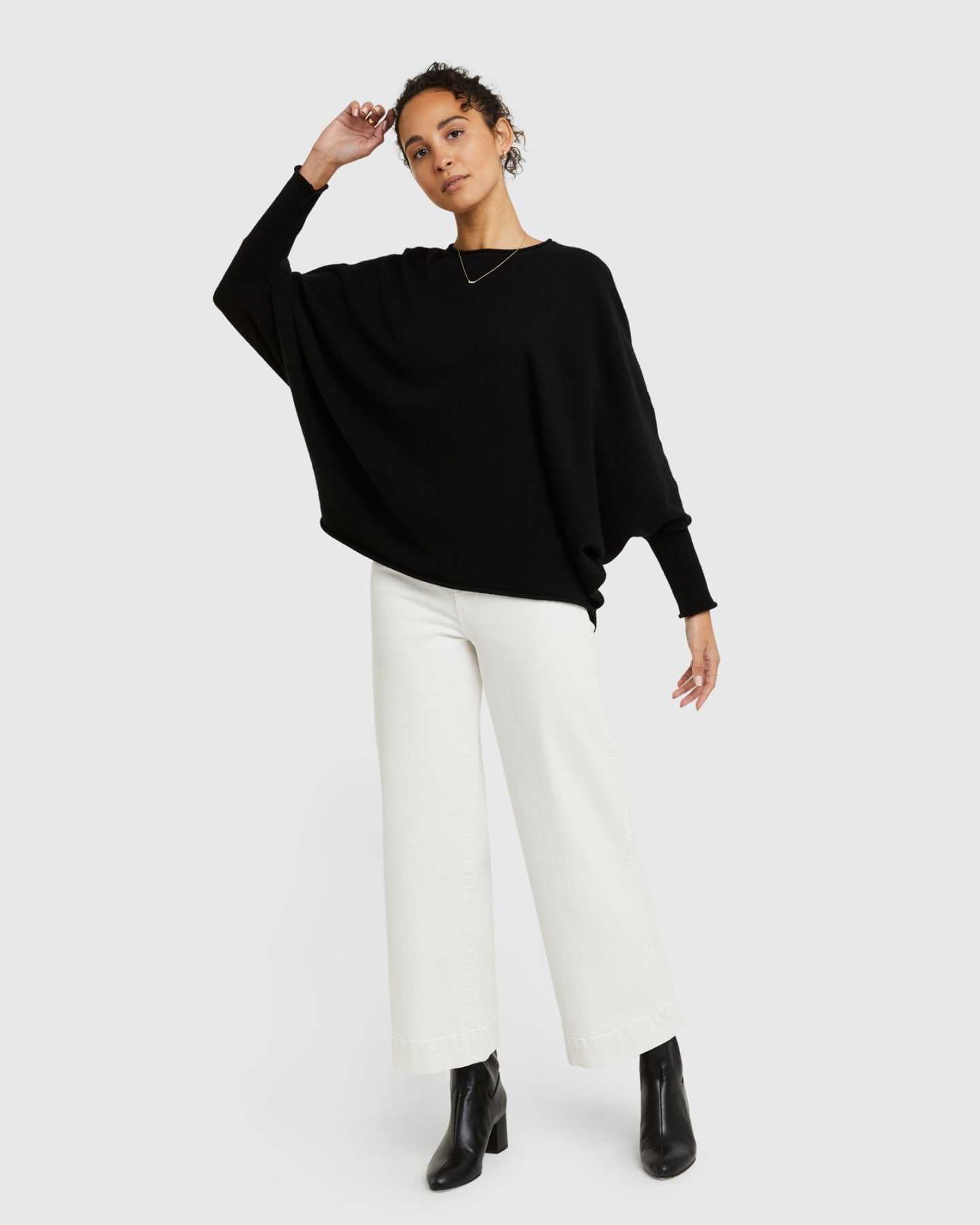 Woman wearing batwing sweater made from cashmere in black from the front again