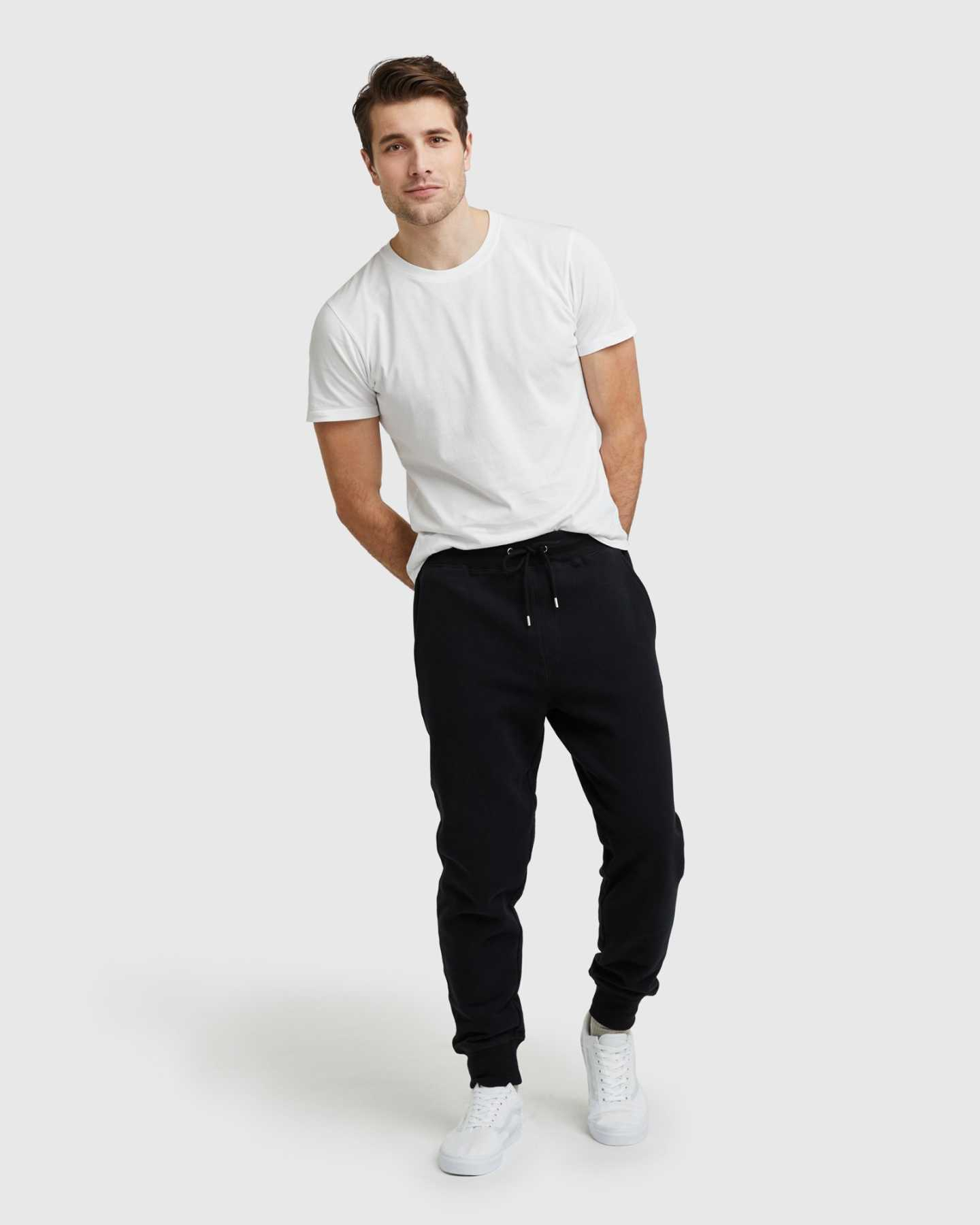 Man wearing 100% organic cotton heavyweight sweatpants in black and white tee