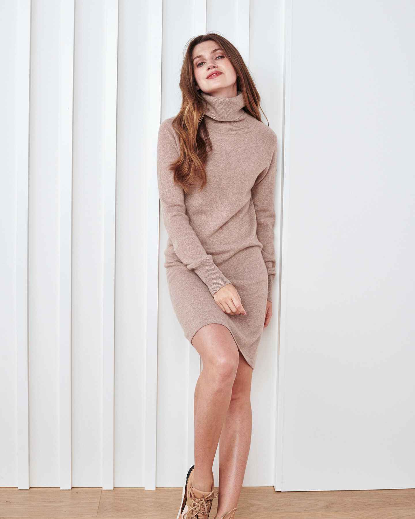 Woman wearing cashmere turtleneck sweater dress