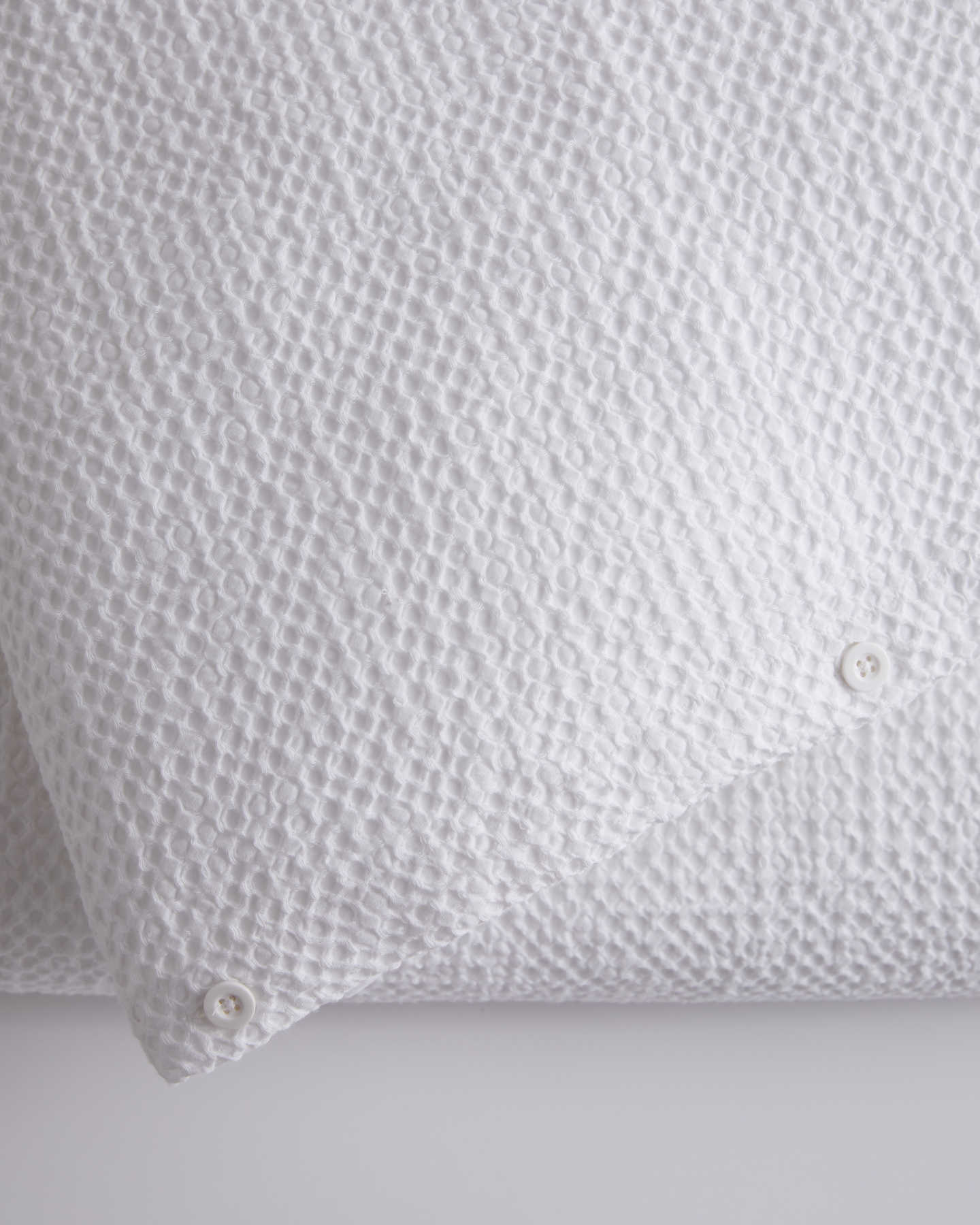 waffle duvet cover on bed zoomed in white color