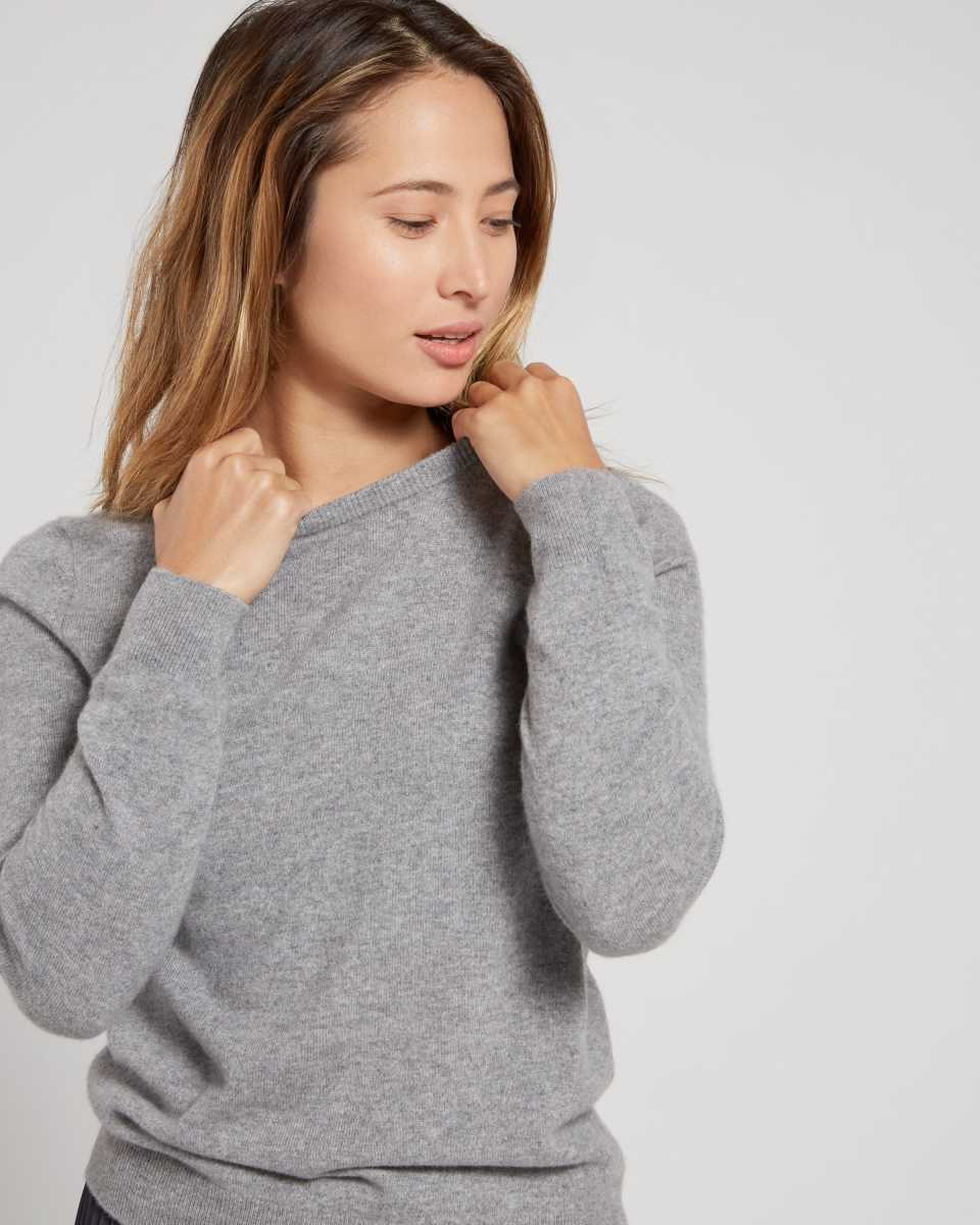 woman wearing grey womens cashmere sweater looking left