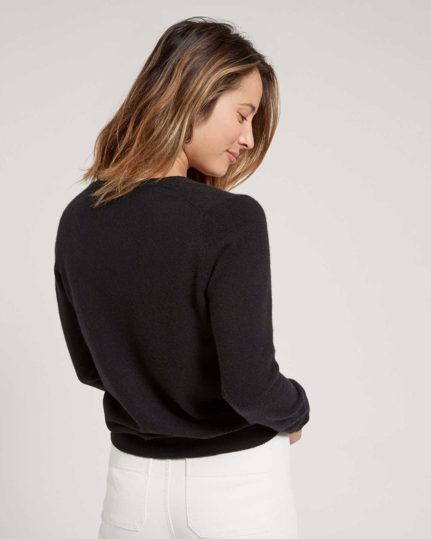 Woman wearing black cashmere v-neck sweater for women
