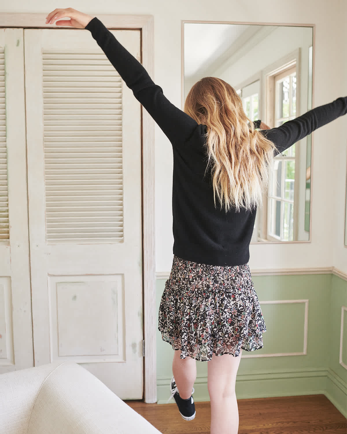 black cashmere sweater women raising arms