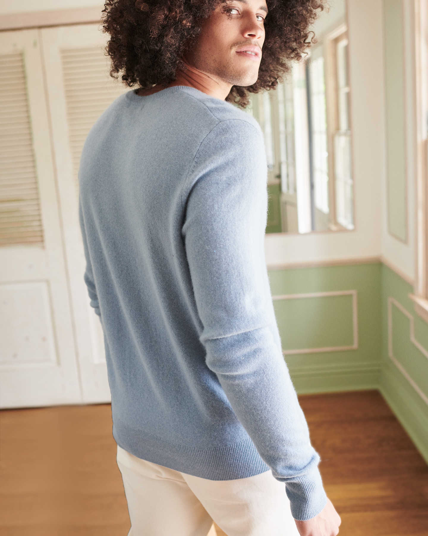 Man wearing blue cashmere v-neck sweater for men from back