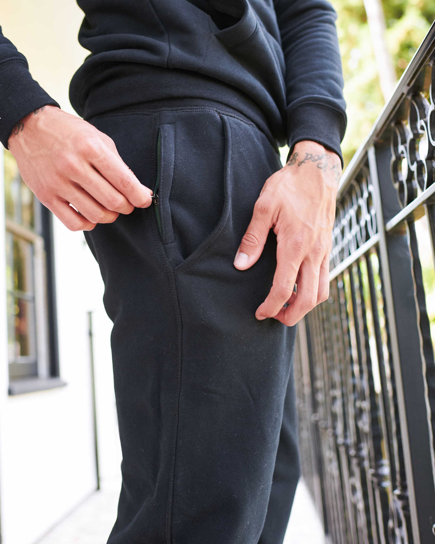 Man wearing 100% organic cotton heavyweight sweatpants in black zoomed in