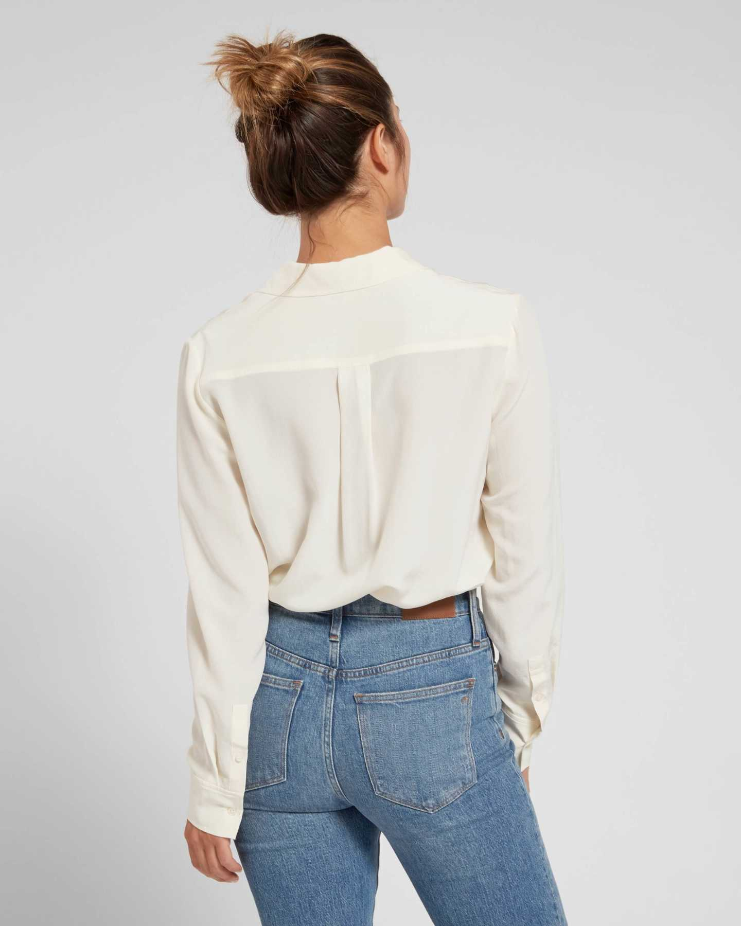Woman wearing womens silk blouse in ivory from back