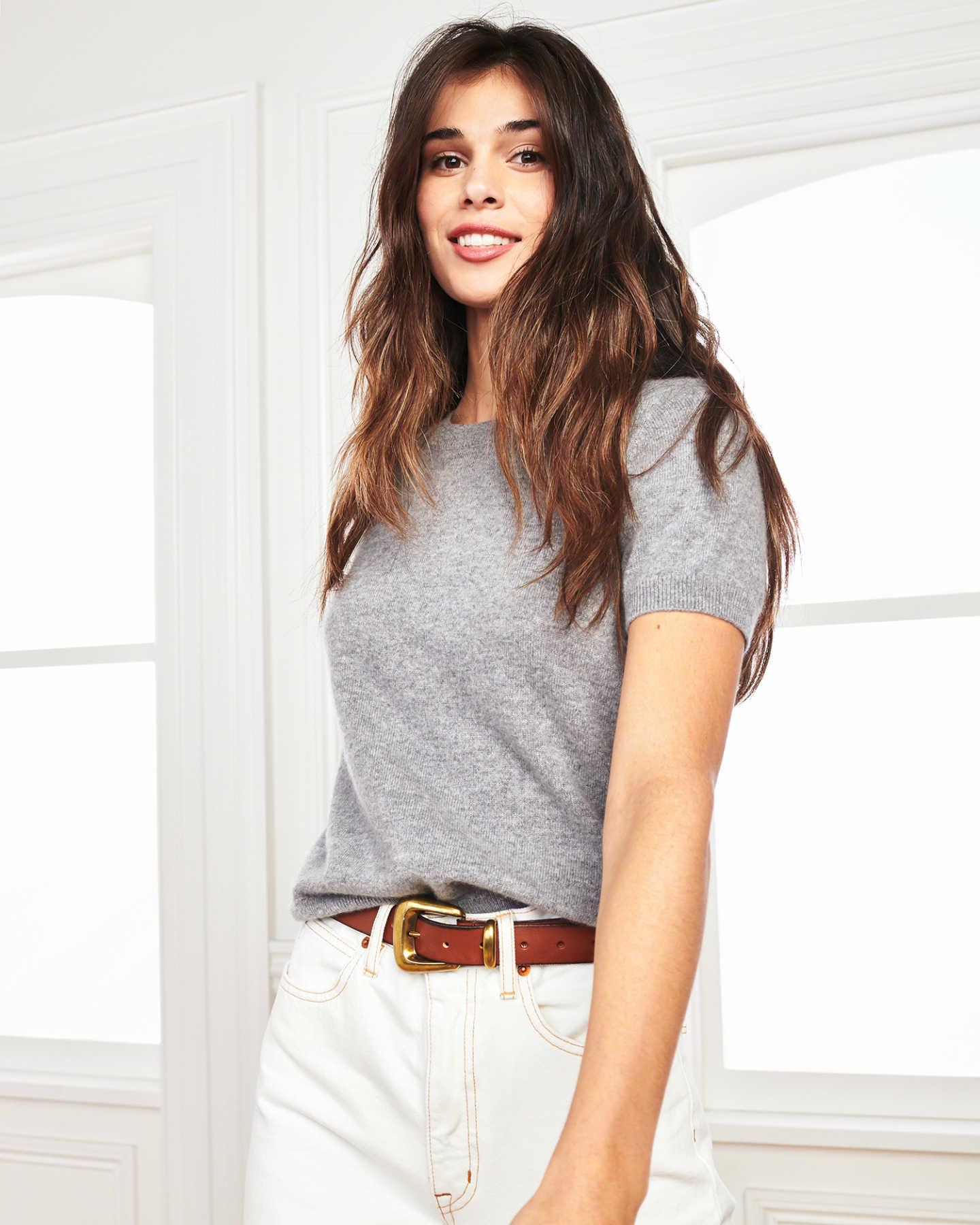 woman wearing grey cashmere tee and short sleeve cashmere sweater posing