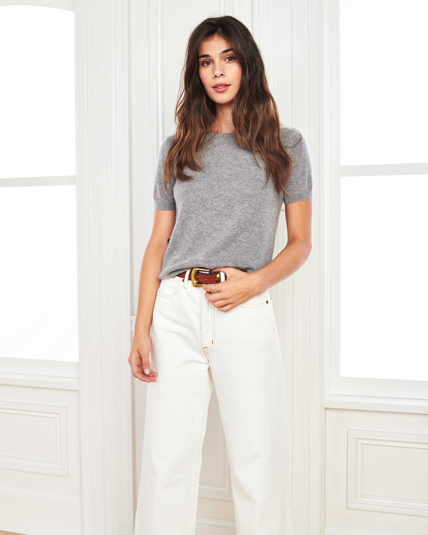 woman wearing grey cashmere tee and short sleeve cashmere sweater by window