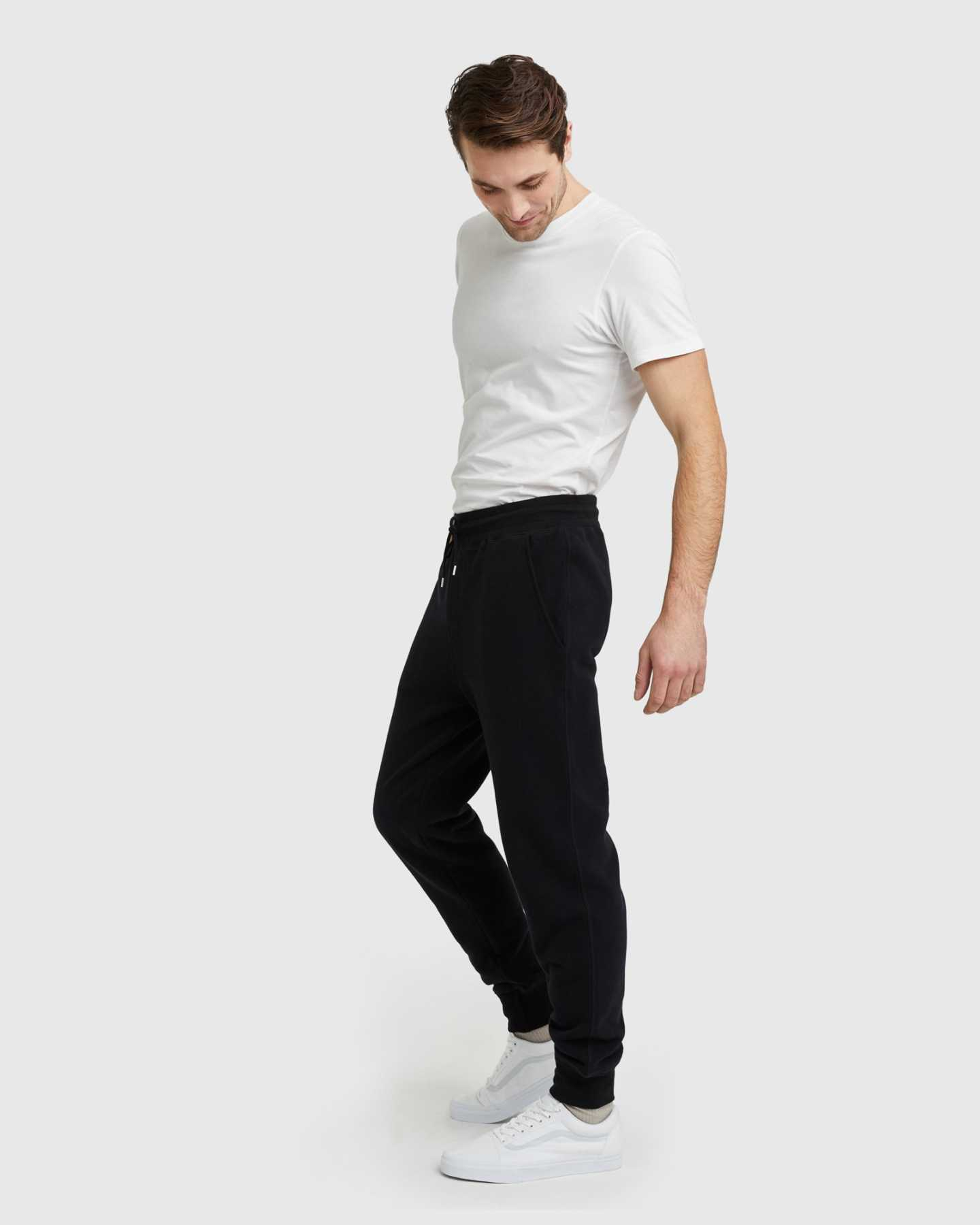 Man wearing 100% organic cotton heavyweight sweatpants in black from angle