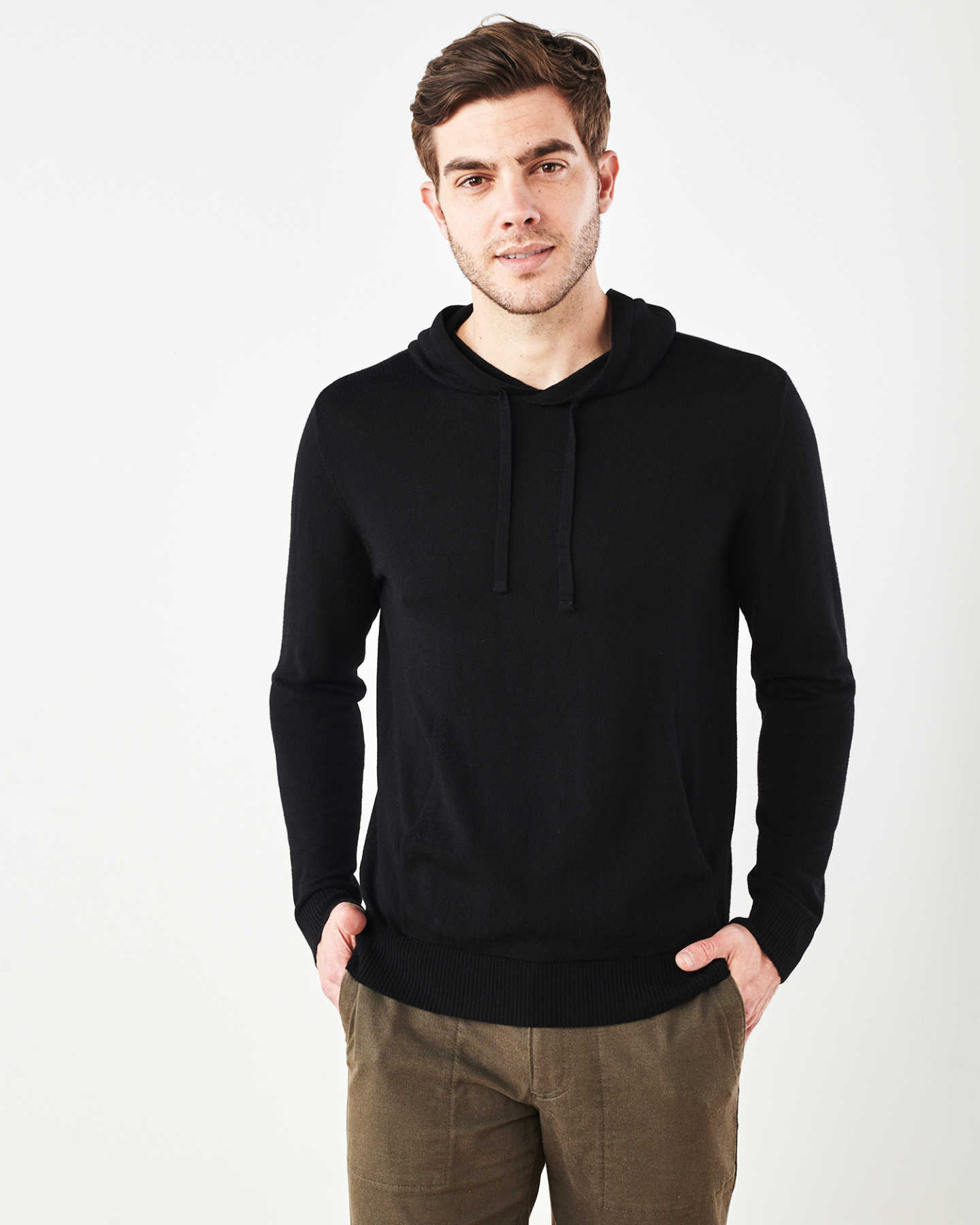 Man wearing merino wool hoodie in black