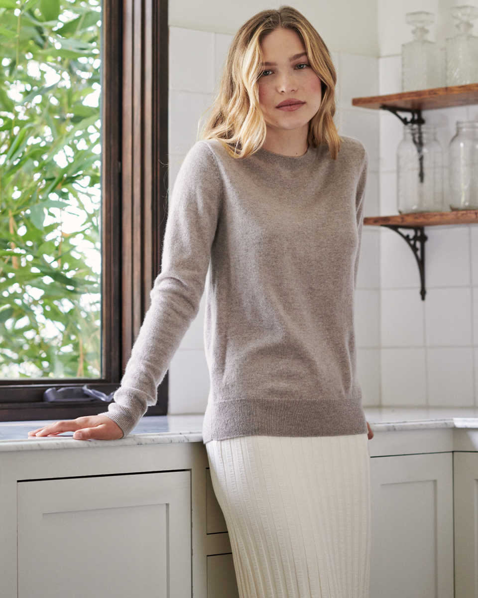 woman wearing oatmeal womens cashmere sweater standing