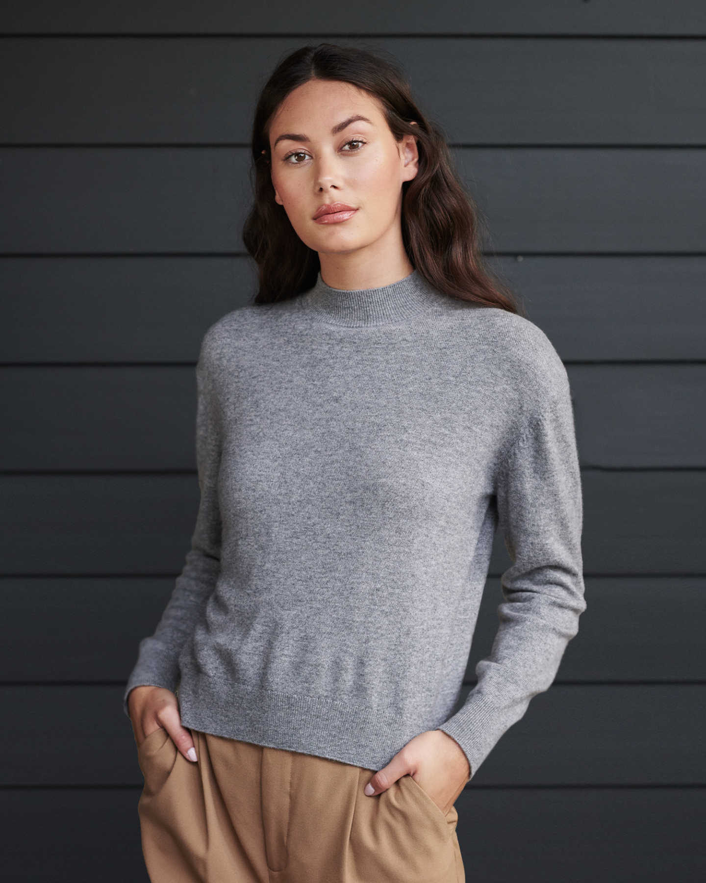 Woman wearing grey cashmere mockneck sweater