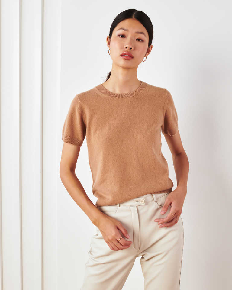 woman wearing camel cashmere tee standing