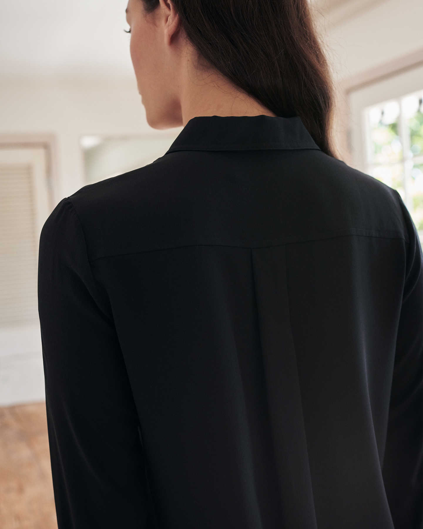 Womens black silk blouse from the back