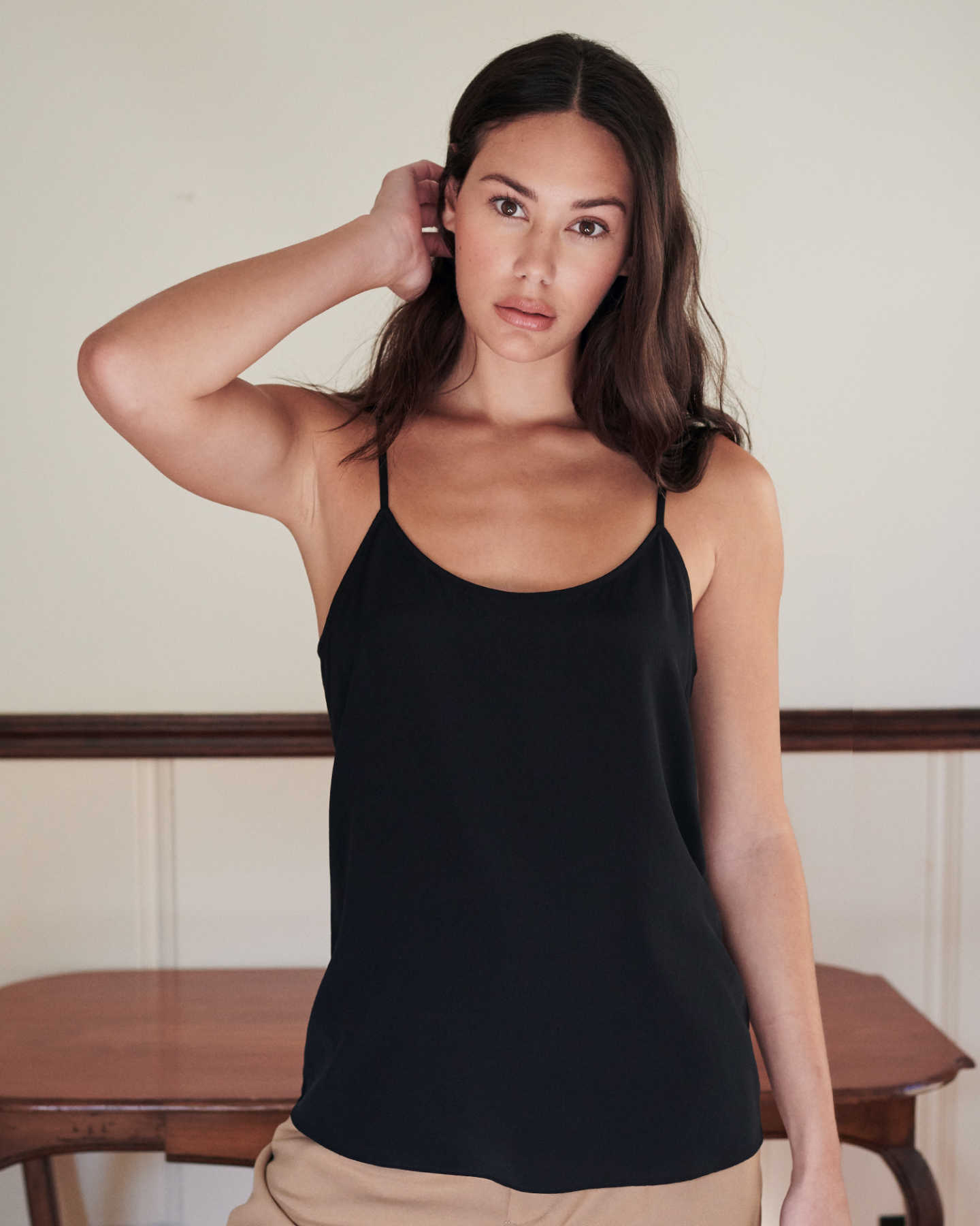 woman wearing silk camisole in black from front