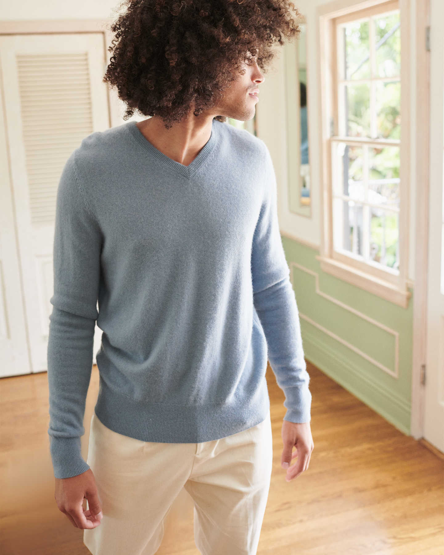 Man wearing blue cashmere v-neck sweater for men looking
