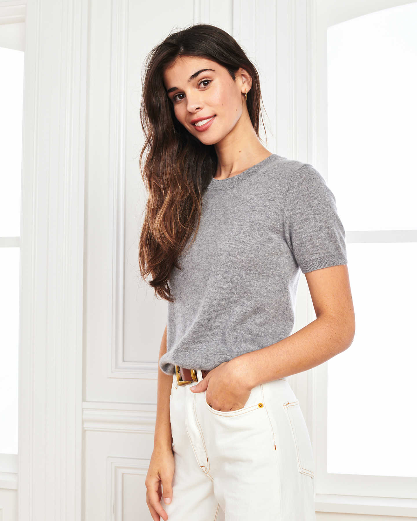 woman wearing grey cashmere tee and short sleeve cashmere sweater angle