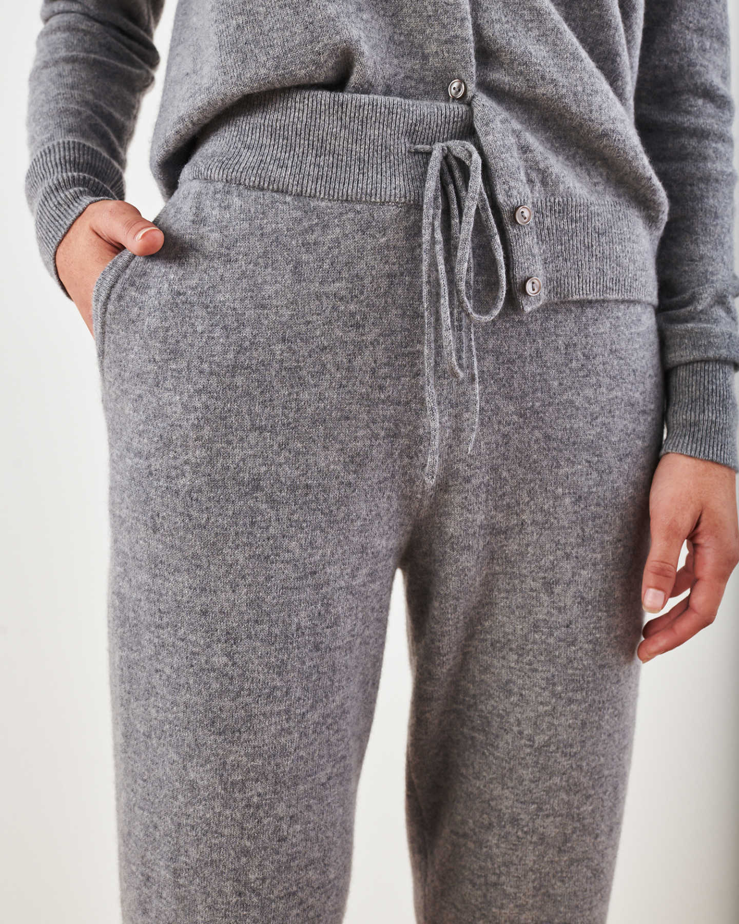 Woman wearing grey cashmere sweatpants & cashmere joggers zoomed in